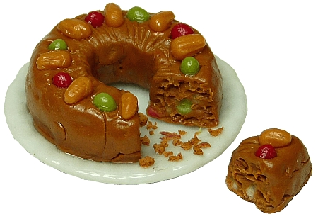 Fruitcake on Plate, cut with Slice